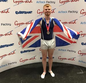 Ashley Reed posing with his silver medal at NDP Finals